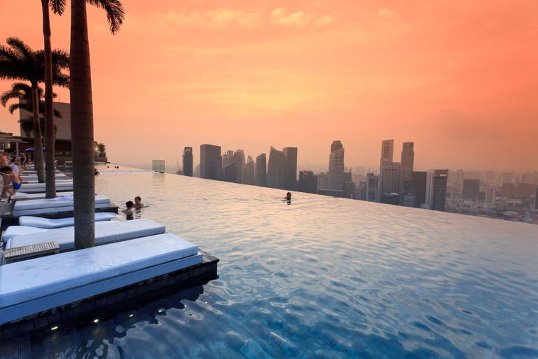 Swimming pool and Singapore Skyline on the 57th floor of Marina Bay Sands Resort, Singapore.