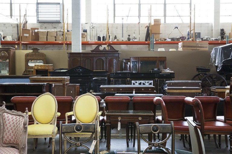 Furniture slated for the August Interiors sale awaits transport to Rockefeller Center