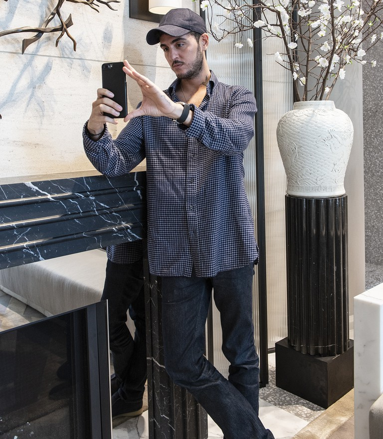 Korban snaps a selfie at his newly designed residential building, 40 Bleecker
