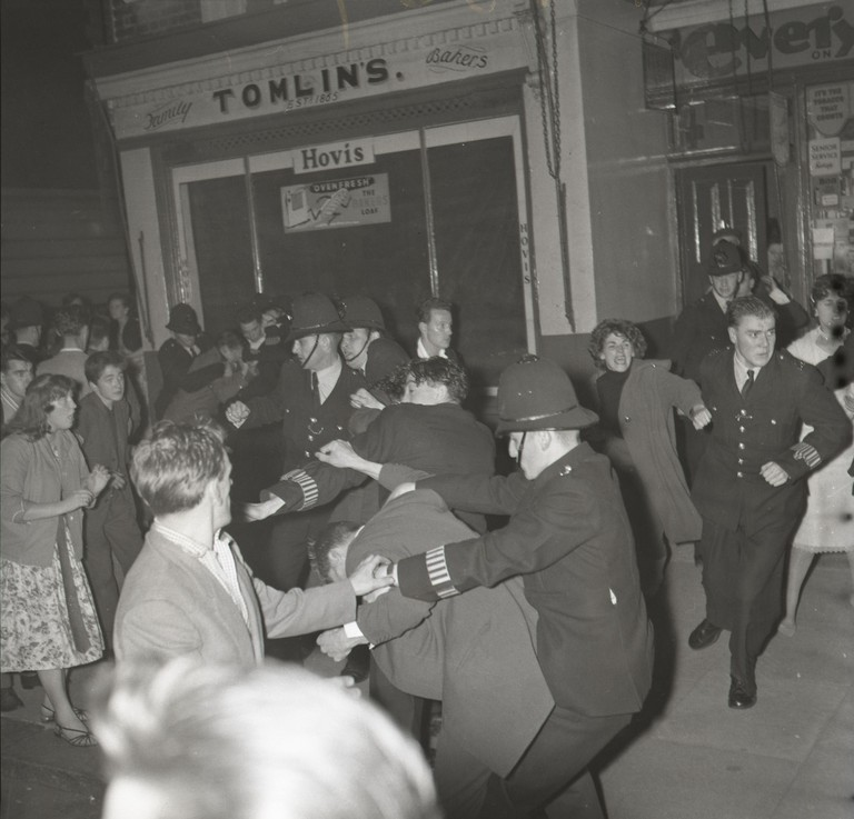 Police break up riots in Notting Hill in 1958