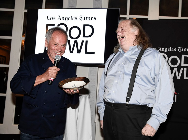 Jonathan Gold (right) presents his Gold Award to chef Wolfgang Puck in 2017
