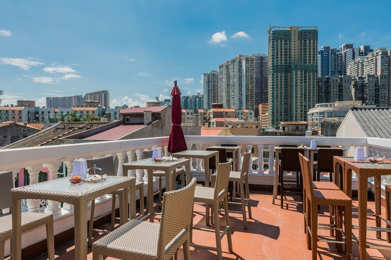 Veranda on the rooftop complete with a bar and stunning views at La Famiglia restaurant, Macau.