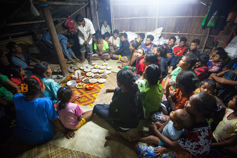 A family gathering inside an Orang Asli home