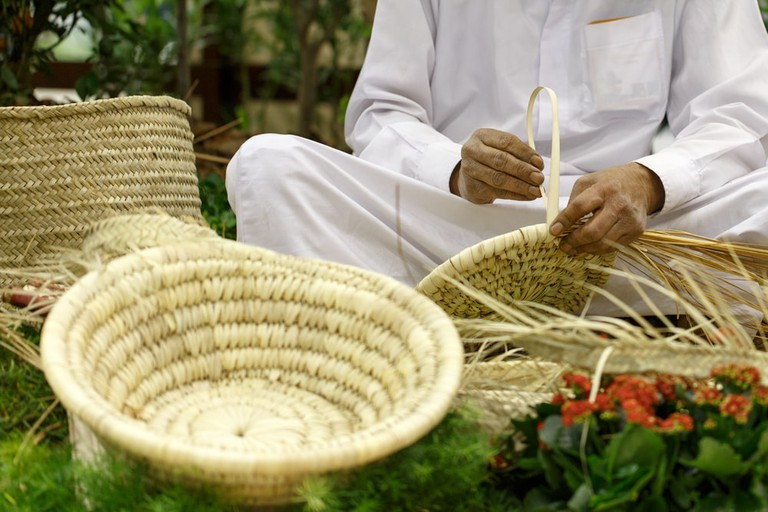 Basket weaving using the dried dates palm leaves, Bahrain.