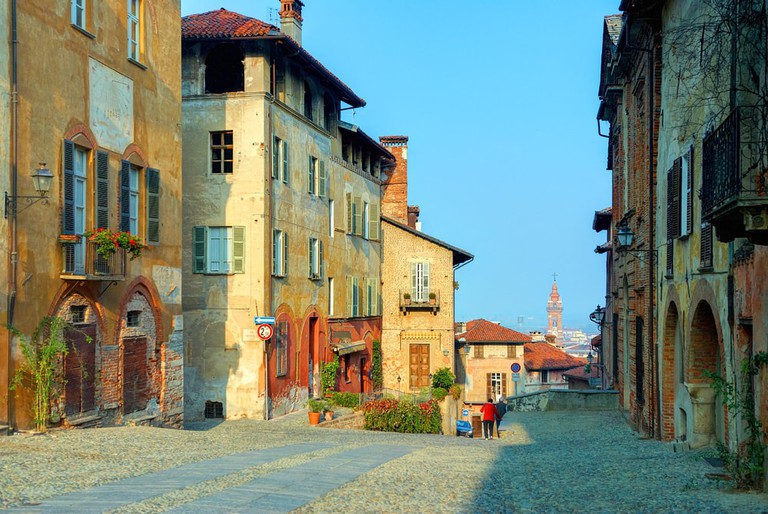 Warm coloured medieval architecture dominates the charming town of Saluzzo, in Piedmont, Italy