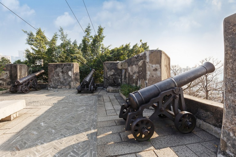 Cannon guarding the battlements of ancient Monte Fort, Macau, China.