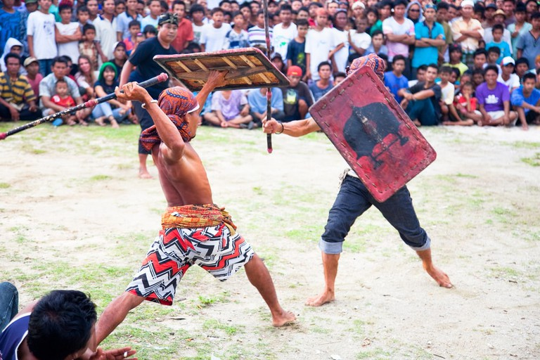 Stick fight between villagers, Lombok, Indonesia.