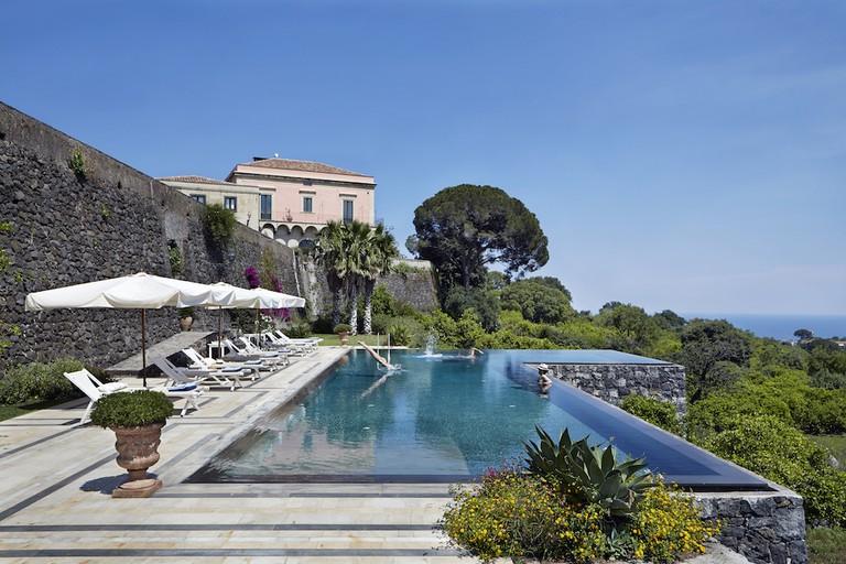 Swim in the villa's pool