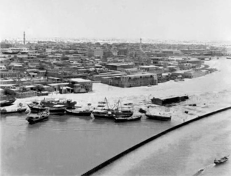 This picture depicts the process of reclaiming land along the Al Ras Waterfront, Dubai, in 1965