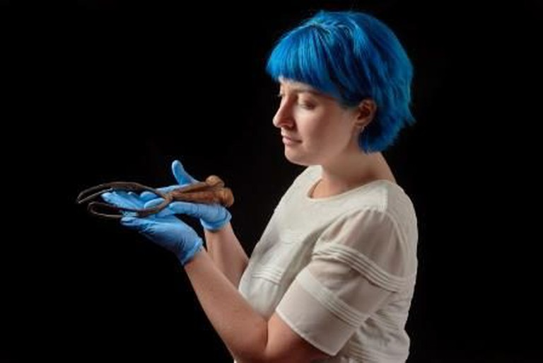 Curator hollding a pair of 'Smellie forceps' c1750 on loan from Royal College of Obstetricians and Gynaecologists, photography John Chase, © Royal College of Physicians