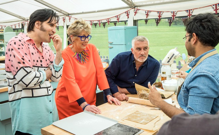 Judges Paul, Prue and presenter Noel with Rahul in the first episode of 2018 Bake Off