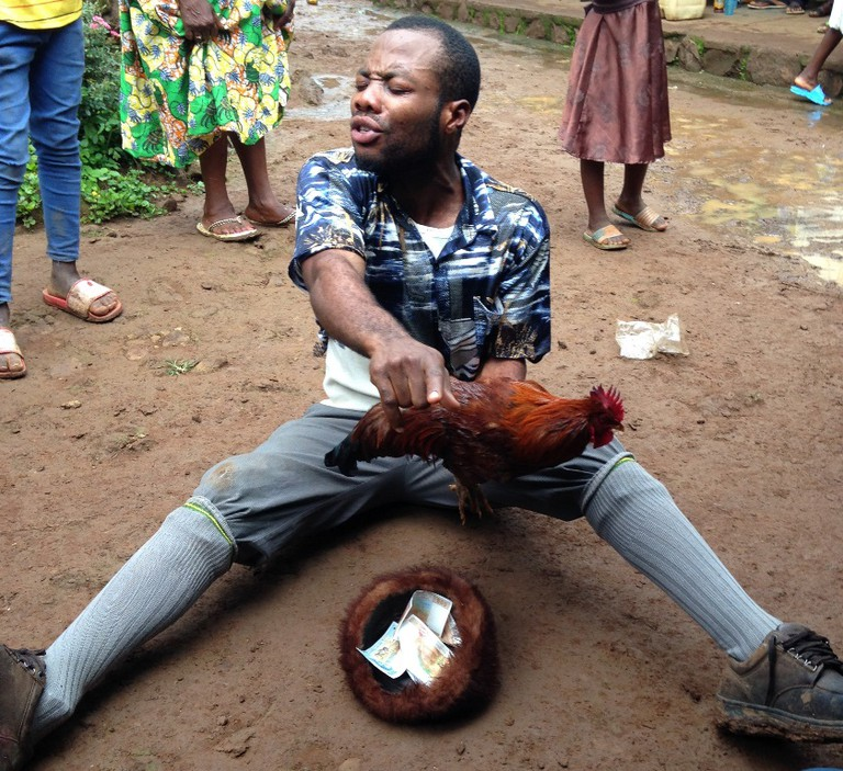 The gwedeng or clown is the chief form of entertainment at traditional weddings in Kom