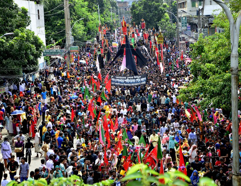 Bangladeshi Shiite Muslims perform a ritual as they take part in a religious procession during the Ashura mourning period in Dhaka.