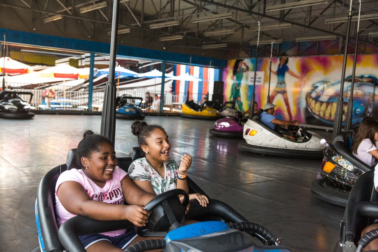 Two young patrons enjoying the bumper cars.