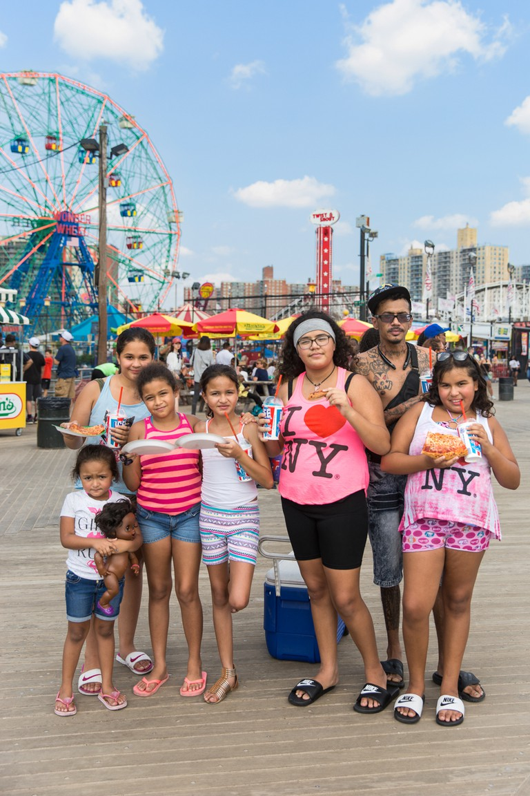 A portrait of John Rodriguez with his 5 daughters and his niece. John and the girls were at Coney celebrating the birthday of his daughter in the striped tank top.