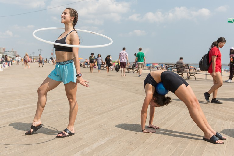 The two friends were hanging out on the boardwalk following their gymnastics practice.