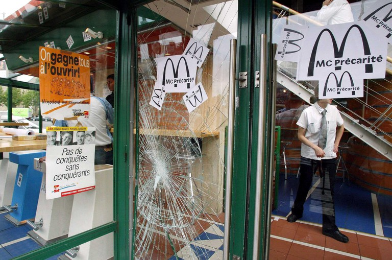 A protest by McDonalds staff in 2003 when they barricaded themselves inside, Paris |© Sipa Press / REX / Shutterstock