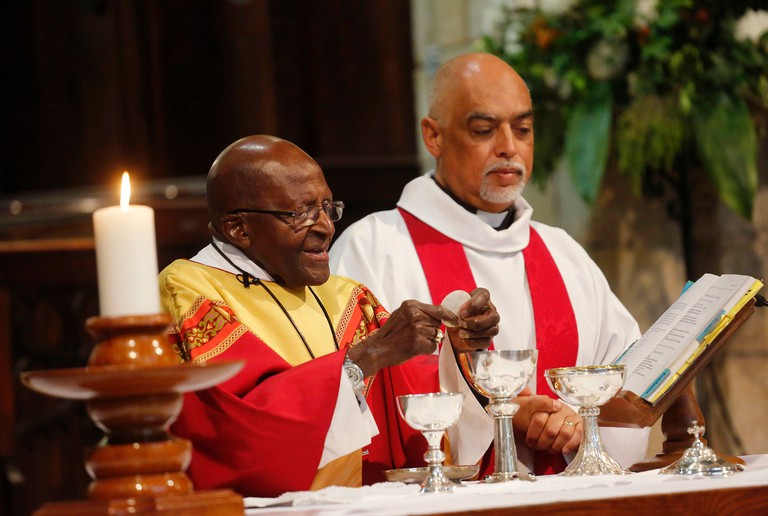 Desmond Tutu, left, gives mass during a church service at St George's Cathedral