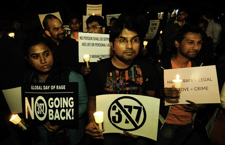 Members of the Lgbt Community Hold Placards (reading 'No 377') and Participate in a Candle Light Vigil to Protest Against the Supreme Court Verdict