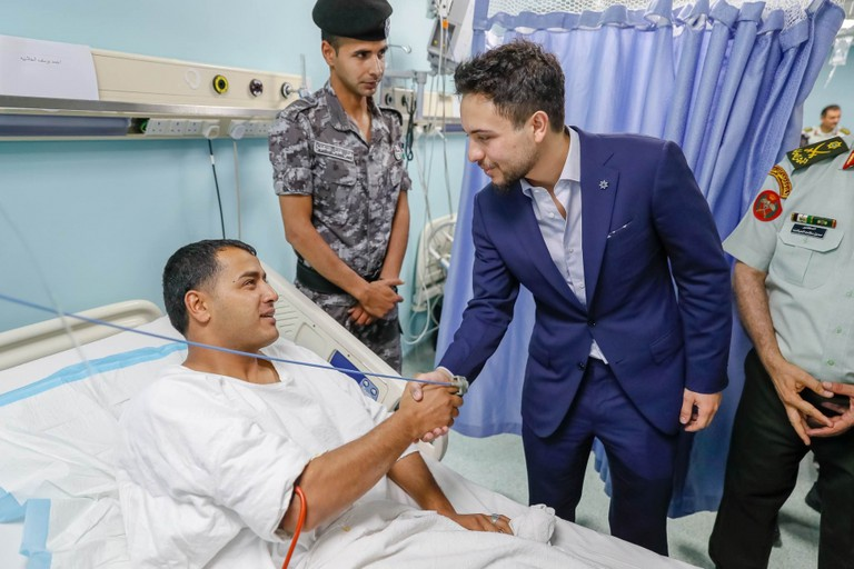 Prince Hussein bin Abdullah checks on injured public security and gendarmerie personnel
