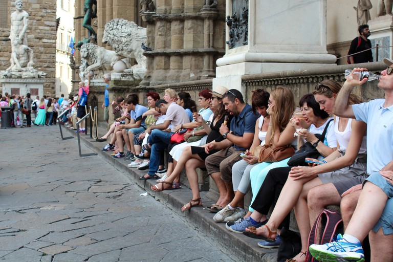 People eating and drinking in Florence, Italy.