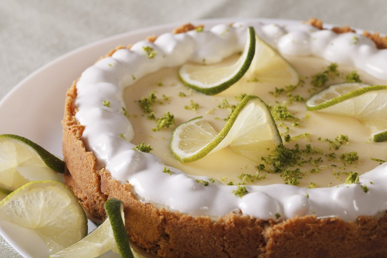 Key lime pie with whipped cream and lime peel.