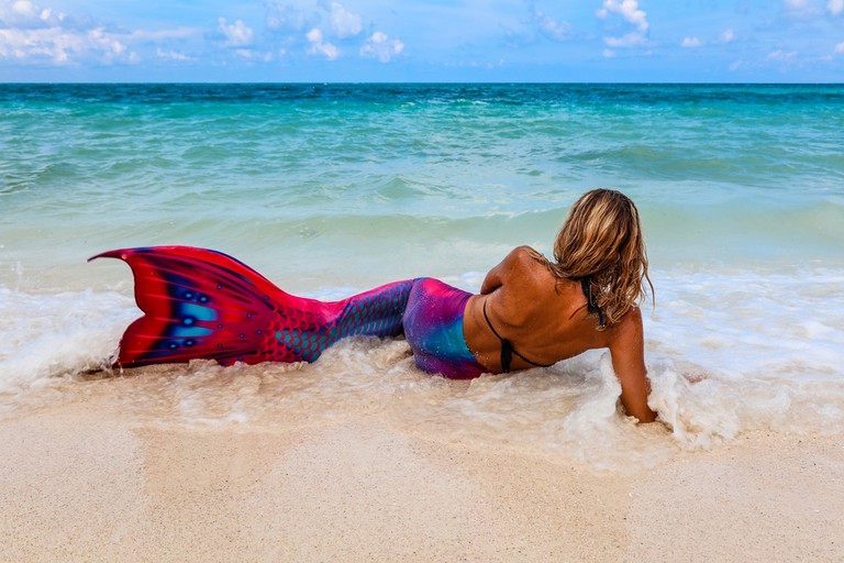 Lady in a Mermaid tail on a beach, Boracay Island, Philippines.