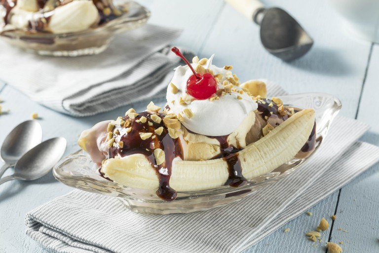 Homemade Banana Split Sundae with chocolate, vanilla, strawberry, ice cream.