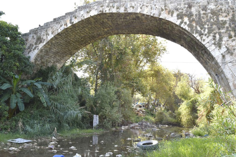 Antic historic bridge above Nahr Ibrahim River in Lebanon