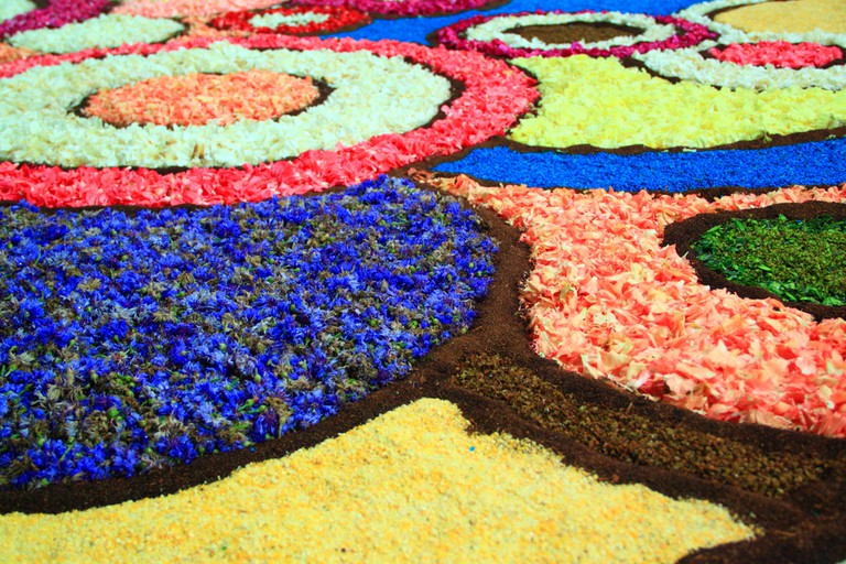 Colourful shapes designed with petals during the Infiorata Festival, Genzano, Italy