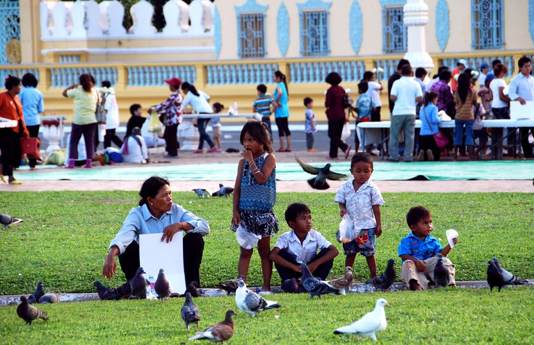 Families flock to the park outside the Royal Palace on Riverside to feed the birds.