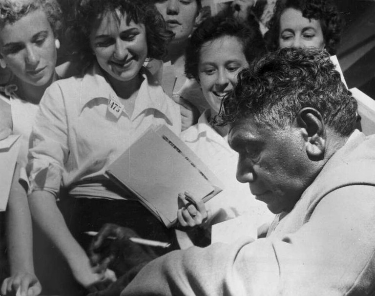 Albert Namatjira signing autographs in the late 1940s © National Library of Australia / Wikimedia Commons