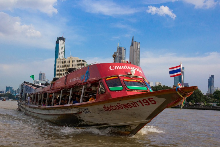 A commuter boat on the Chaophraya River in Bangkok, Thailand