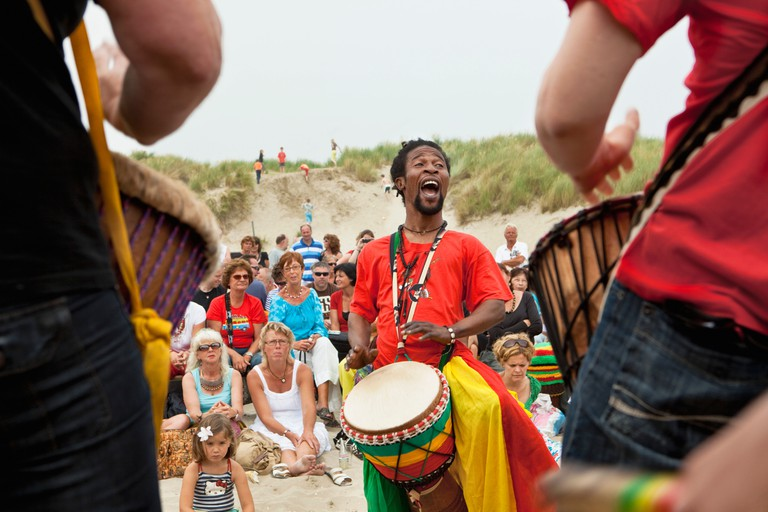 Djembe demonstration on beach in IJmuiden, the Netherlands by artist Mousse Drame, original from Senegal.