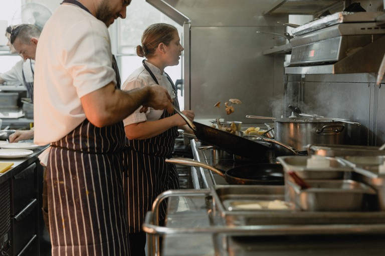 Chefs work in the kitchen of the Harwood Arms to make Sunday roasts