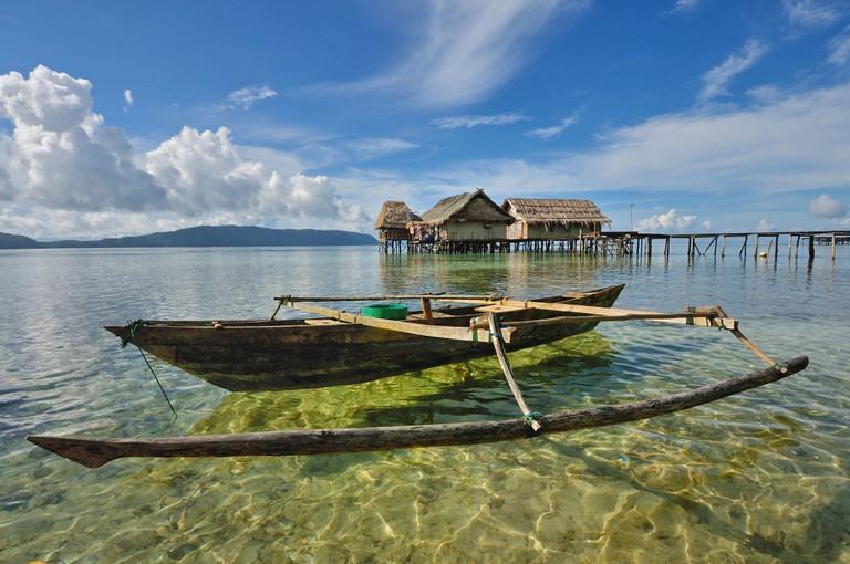 Traditional boat at Arborek Village, Raja Ampat