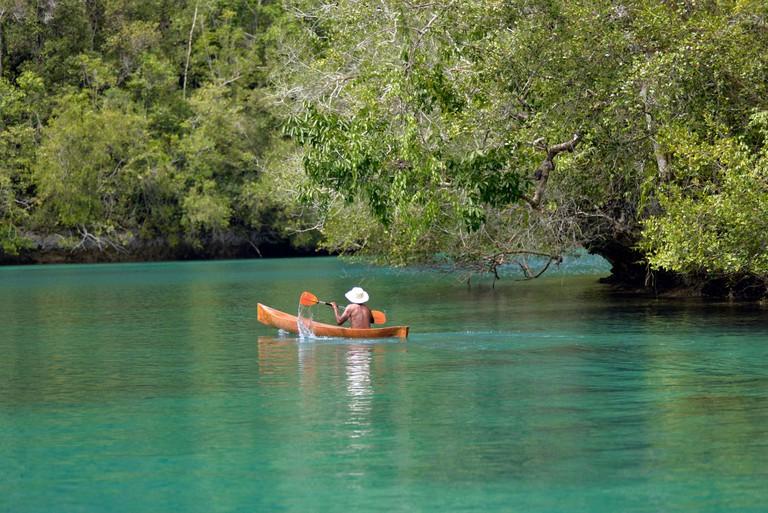 Canoing in Kabui Bay Waigeo Raja Ampat Indonesia