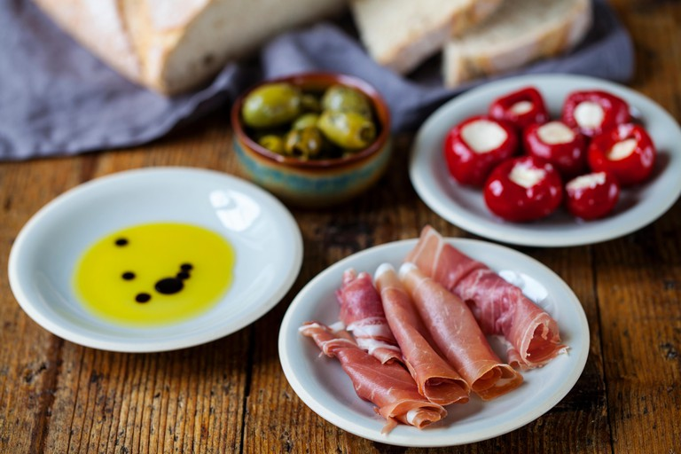 Spanish tapas: stuffed peppers, olives and bread