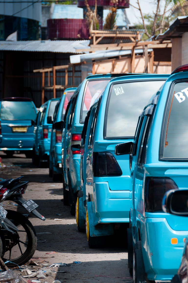 A queue of transportation vans in Sorong, Indonesia
