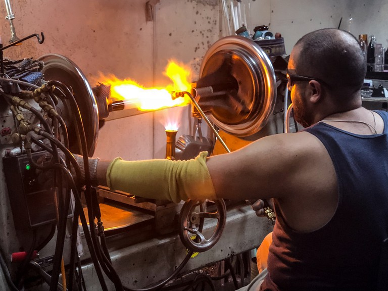 In a glassblower's studio with GreenTours.com