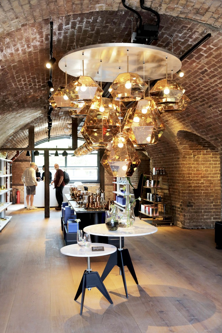The British interiors designer, Tom Dixon's new showroom on Bagley Walk Arches, in the CYD, the new shopping street at Kings Cross, London, UK