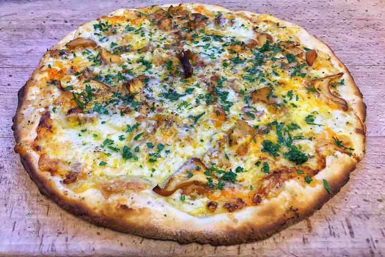 One of the pizza offerings at Lofthus Samvirkelag, Courtesy of Lofthus Samvirkelag