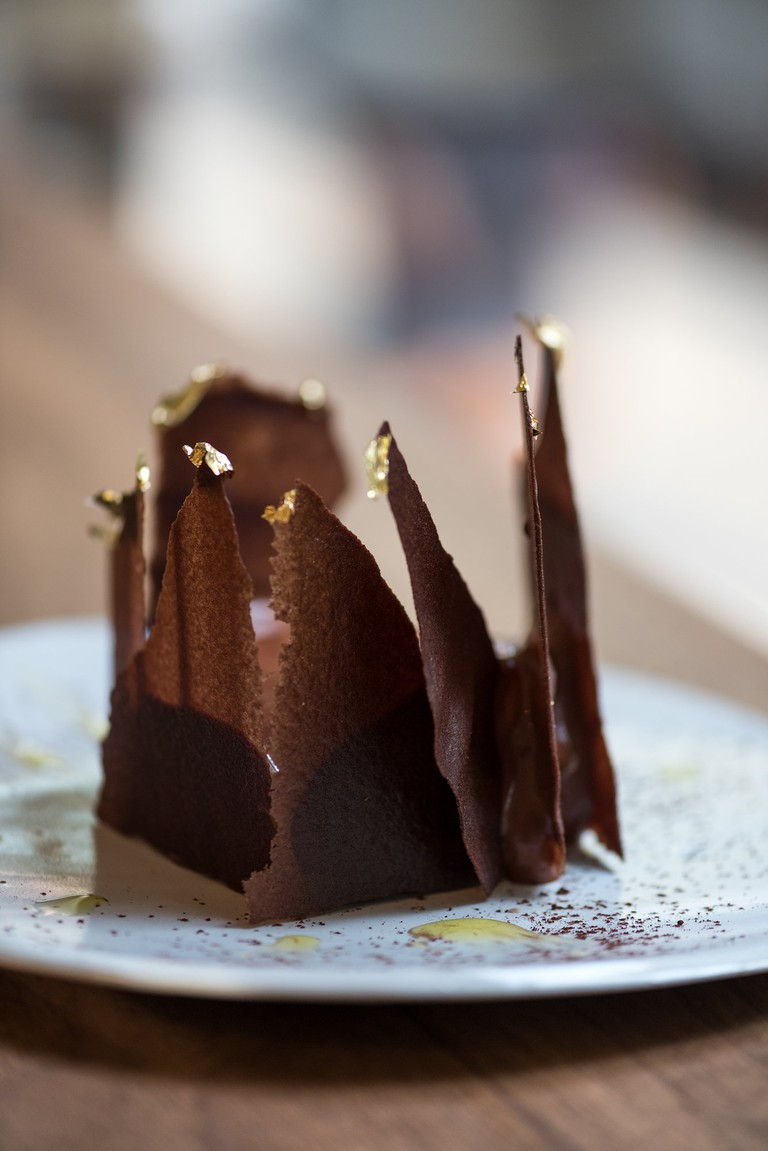 Shards of chocolate rise out of a chocolate ganache and goat's cheese mousse