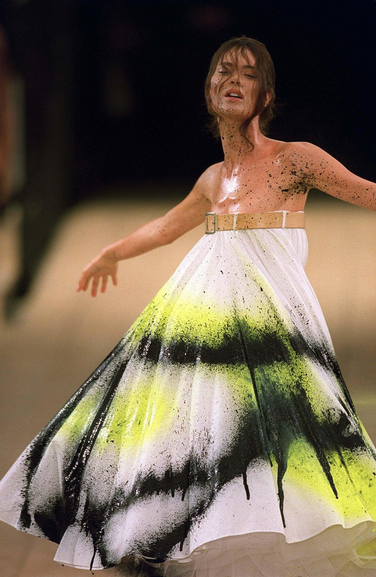 The spray-painted model at McQueen's SS99 show