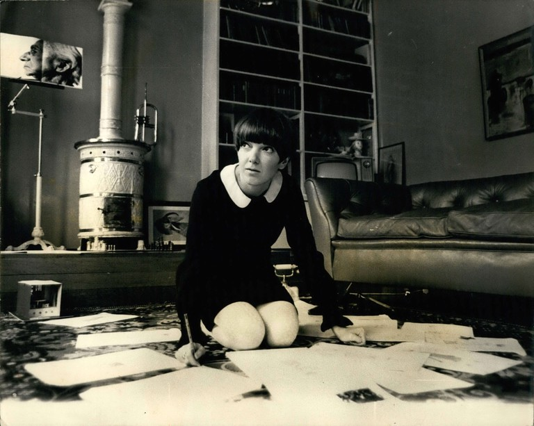 Designer Mary Quant seen at work in her flat. 1968, London.