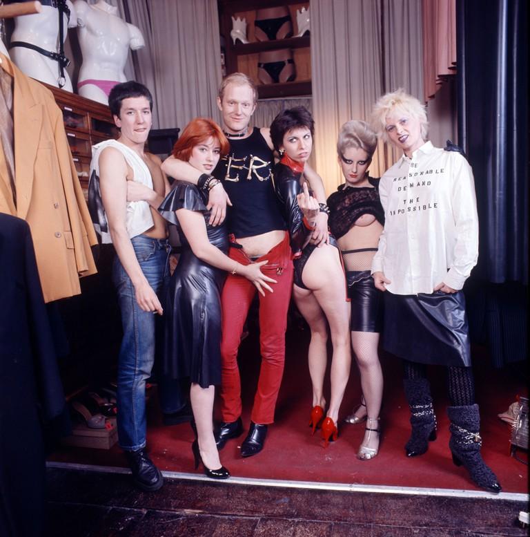 Steve Jones, Alan Jones, Chrissie Hynde, Jordan and Vivienne Westwood at Westwood's shop 'Sex'. 1976, Kings Road, London.