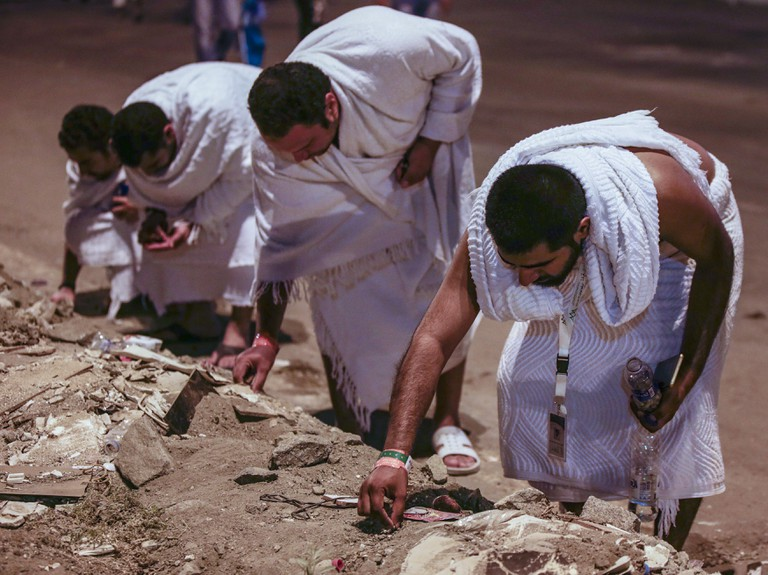 Muslim pilgrims look for pebbles at the Muzdalifah outside Mecca