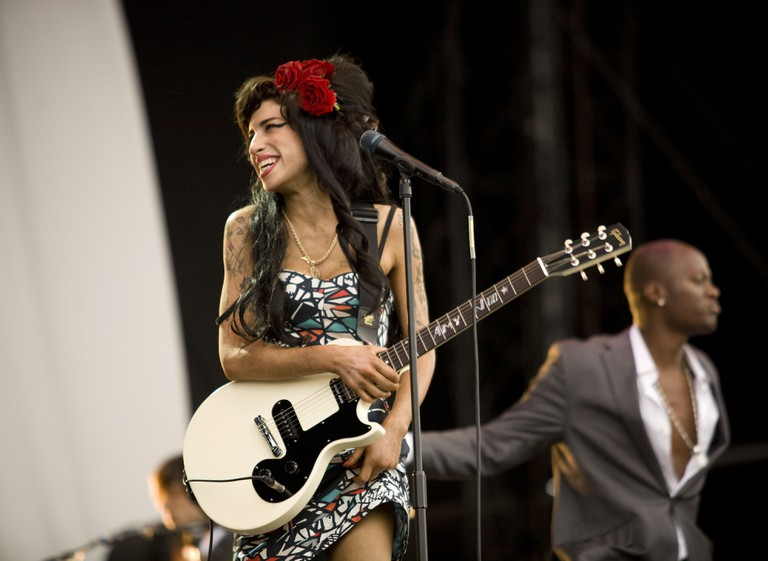 Amy Winehouse, an English singer and songwriter, was known for her deep, expressive contralto vocals and her eclectic mix of musical genres, including soul, rhythm and blues, and jazz, photographed at the Virgin Mobile V Festival, Hylands Park, Chelmsford, Essex, Britain - Aug 2009.