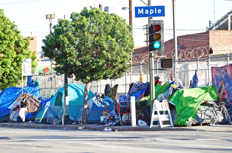 Homeless encampment along the roadside depicting the growing epidemic of homelessness in the City of Los Angeles, California, USA.