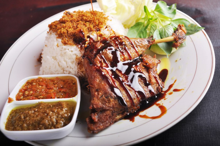 Fried duck rice typical of madura island, indonesia.
